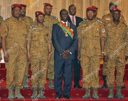 Michel Kafando (c) Poses For a Photograph with Military Leaders During the Swearing in Ceremony As the Country's Transitional President in Ouagadougou Burkina Faso 18 November 2014 Former Foreign Minister Michel Kafando was Sworn in As Burkina Faso's Transitional President Following Weeks of Uncertainty and Will Lead the Country Until Elections November 2015 President Blaise Compaore Stepped Down After Massive Protests in the Capital Against His Attempt to Extend His 27-year Rule in Burkina Faso in October Burkina Faso Ouagadougou