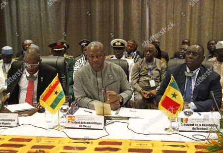 President of Ghana John Mahama Dramani (c) President of Senegal Macky Sall (r) and President of Nigeria Goodluck Jonathan (l) Attend a Meeting of Ecowas Leaders and the Transitional Leader of Burkina Faso Lieutenat-colonel Isaac Zida (not Pictured) in Ouagadougou Burkina Faso 05 November 2014 the Presidents of Ghana Nigeria and Senegal Visited Ouagadougou to Meet with the Military to Negotiate For the Return to Civilian Rule President Blaise Compaore on 31 October 2014 Resigned Following the Violent Protests Against His Bid to Change the Constitution to Extend His Rule of 27 Years Presidential Guard Commander Lieutenat-colonel Isaac Zida Assumed the Role of Transitional Leader But the African Union (au) Has Issued the Military a Two-week Time Frame to Hand Power to a Civilian Ruler Or Face Sanctions Burkina Faso Ouagadougou