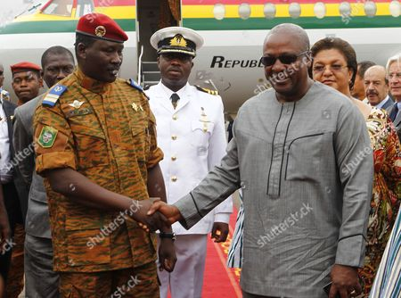 Transitional Leader of Burkina Faso Lieutenat-colonel Isaac Zida (l) Meets with President of Ghana John Mahama Dramani (r) at the Airport Prior to a Meeting of Ecowas Leaders in Ouagadougou Burkina Faso 05 November 2014 the Presidents of Ghana Nigeria and Senegal Visited Ouagadougou to Meet with the Military to Negotiate For the Return to Civilian Rule President Blaise Compaore on 31 October 2014 Resigned Following the Violent Protests Against His Bid to Change the Constitution to Extend His Rule of 27 Years Presidential Guard Commander Lieutenat-colonel Isaac Zida Assumed the Role of Transitional Leader But the African Union (au) Has Issued the Military a Two-week Time Frame to Hand Power to a Civilian Ruler Or Face Sanctions Burkina Faso Ouagadougou