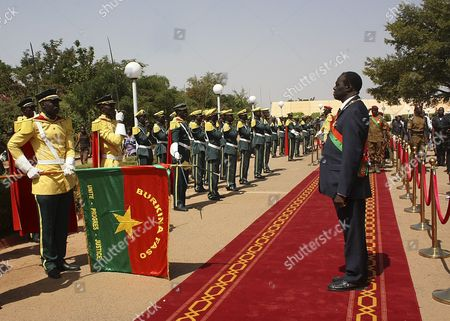 Michel Kafando Reviews a Guard of Honour After Being Sworn in As the Transitional President of Burkina Raso in Ouagadougou Burkina Faso 18 November 2014 Former Foreign Minister Michel Kafando was Sworn in As Burkina Faso's Transitional President Following Weeks of Uncertainty and Will Lead the Country Until Elections November 2015 President Blaise Compaore Stepped Down After Massive Protests in the Capital Against His Attempt to Extend His 27-year Rule in Burkina Faso in October Burkina Faso Ouagadougou