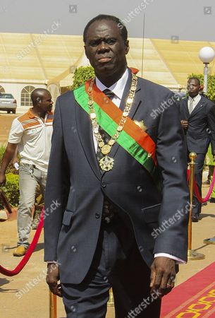 Michel Kafando Walks to Review a Guard of Honour After Being Sworn in As the Transitional President of Burkina Raso in Ouagadougou Burkina Faso 18 November 2014 Former Foreign Minister Michel Kafando was Sworn in As Burkina Faso's Transitional President Following Weeks of Uncertainty and Will Lead the Country Until Elections November 2015 President Blaise Compaore Stepped Down After Massive Protests in the Capital Against His Attempt to Extend His 27-year Rule in Burkina Faso in October Burkina Faso Ouagadougou