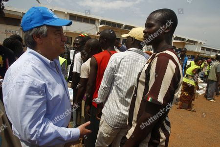 The High Commissioner of the Un Unhcr Antonio Guterres (l) Talks to a Refugee During His Visit to a Refugee Camp For Internally Displaced Persons at the Airport of Mpoko in Bangui Central African Republic 12 February 2014 Thousands Have Been Killed and One Million Displaced in the Past 13 Months After the Mainly Muslim Armed Opposition Alliance Seleka Rose Up Against the Government and Overthrew President Francois Bozize a Christian in March 2013 Bozize's Muslim Successor Michel Djotodia was Pressured to Cede Power in January But the Election of Catherine Samba-panza a Christian As Interim President Has Been Unable to Stem the Violence Central African Republic Bangui