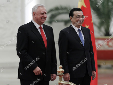 Belarus Prime Minister Mikhail Myasnikovich (l) and Chinese Premier Li Keqiang (r) Laugh Together During a Welcome Ceremony at the Great Hall of the People in Beijing China 20 January 2014 Myasnikovich is on an Official Visit to China and is Expected to Hold Meetings with Chinese Counterparts to Boost Ties Between the Two Countries China Beijing