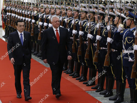 Chinese Premier Li Keqiang (l) and Belarus Prime Minister Mikhail Myasnikovich (r) Walk Past Chinese Honor Guards During a Welcome Ceremony at the Great Hall of the People in Beijing China 20 January 2014 Myasnikovich is on an Official Visit to China and is Expected to Hold Meetings with Chinese Counterparts to Boost Ties Between the Two Countries China Beijing