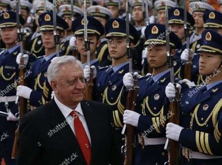 Belarus Prime Minister Mikhail Myasnikovich Walks Past Chinese Honor Guards During a Welcome Ceremony at the Great Hall of the People in Beijing China 20 January 2014 Myasnikovich is on an Official Visit to China and is Expected to Hold Meetings with Chinese Counterparts to Boost Ties Between the Two Countries China Beijing