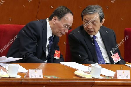 Secretary of the Central Commission For Discipline Inspection Wang Qishan (l) Talks with Chinese Vice Premier Ma Kai During the Third Plenary Meeting of the Third Session of the 12th National People's Congress (npc) at the Great Hall of the People in Beijing China 12 March 2015 the Npc Has Over 3 000 Delegates and is the World's Largest Parliament Or Legislative Assembly Though Its Function is Largely As a Formal Seal of Approval For the Policies Fixed by the Leaders of the Chinese Communist Party China Beijing