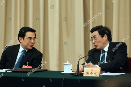 Guo Jinlong (r) the Secretary of the Beijing Municipal Committee of the Communist Party of China (cpc) Talks with Wang Anshun (l) the Mayor of Beijing at the Beijing Delegation's Group Discussion During the Third Session of the 12th National People's Congress (npc) at the Great Hall of the People in Beijing China 06 March 2015 the Npc Has Over 3 000 Delegates and is the World's Largest Parliament Or Legislative Assembly Though Its Function is Largely As a Formal Seal of Approval For the Policies Fixed by the Leaders of the Chinese Communist Party China Beijing
