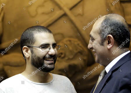 Egyptian Activist Alaa Abdel-fatah (l) Stands with Khaled Ali (r) One of Abdel Fatah's Defence Lawyers and an Ex-presidential Candidate While Attending a Press Conference Launching a Campaign Called 'Against Protest Law' Against Egypt's Protest Laws at the Press Syndicate Cairo Egypt 17 September 2014 According to Local Sources Campaigners Plan to Use All Peaceful Means to Protest the Law Implemented Under the Interim Presidency of Adly Mansour in Novermber 2013 Which Led to the Imprisonment of Many Deemed to Have Broken the Law who Receieved Long Prison Sentences Including Abdel Fatah who Along with Many Other Detainees Began a Hunger Strike in a Protest Which Has Been Joined by Activists Supporting Their Cause Egypt Cairo