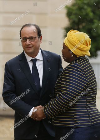 Stock Image of French President Francois Hollande (l) Greets Africa Union Commission Chairperson Nkosazana Clarice Dlamini Zuma (r) Upon Her Arrival at the Elysee Palace in Paris France 06 October 2014 France Paris