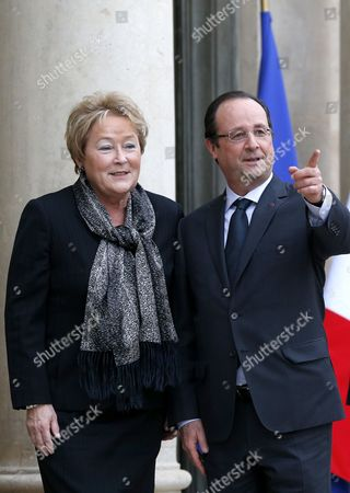Stock Image of French President Francois Hollande (r) Greets Prime Minister of Quebec Pauline Marois (l) Upon Her Arrival at the Elysee Palace in Paris France 17 December 2013 Marois is on an Official Visit to France France Paris