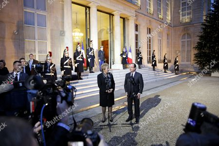 Stock Photo of French President Francois Hollande (c-r) and Prime Minister of Quebec Pauline Marois (c-l) Talk to the Media After Their Meeting at the Elysee Palace in Paris France 17 December 2013 Marois is on an Official Visit to France France Paris