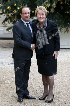 French President Francois Hollande (l) Greets Prime Minister of Quebec Pauline Marois (r) Upon Her Arrival at the Elysee Palace in Paris France 17 December 2013 Marois is on an Official Visit to France France Paris