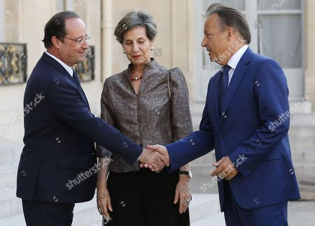 French President Francois Hollande (l) Greets President of the French Senate Jean-pierre Bel (r) and Chilean President of Senate Isabel Allende (c) at the Elysee Palace in Paris France 23 June 2014 Allende was Honored Earlier at the French Senate France Paris