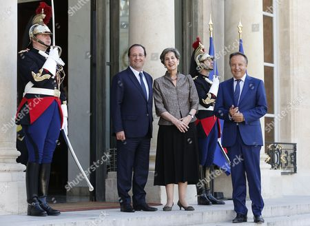French President Francois Hollande (2-l) Greets President of the French Senate Jean-pierre Bel (r) and Chilean President of Senate Isabel Allende (c) at the Elysee Palace in Paris France 23 June 2014 Allende was Honored Earlier at the French Senate France Paris