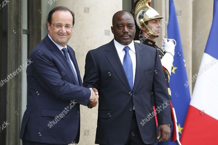 French President Francois Hollande (l) Greets President of the Democratic Republic of the Congo Joseph Kabila Kabange (r) Upon His Arrival at the Elysee Palace in Paris France 21 May 2014 France Paris