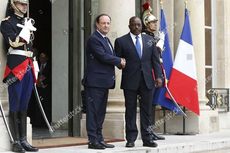French President Francois Hollande (2-l) Greets President of the Democratic Republic of the Congo Joseph Kabila Kabange (2-r) Upon His Arrival at the Elysee Palace in Paris France 21 May 2014 France Paris