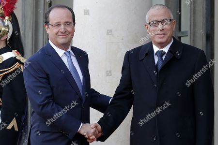 French President Francois Hollande (l) Greets Libyan Prime Minister Ali Zeidan (r) As Part of the Elysee Summit For Peace and Security in Africa at the Elysee Palace in Paris France 06 December 2013 Elysee Summit For Peace and Security in Africa Takes Place on 06 and 07 December 2013 As France Prepares to Launch Its Second Intervention in Africa in Central African Republic in Under a Year African Leaders Are Bound For Paris to Discuss How to Reduce Their Reliance on the Military Muscle of Former Colonial Powers France Paris