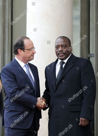French President Francois Hollande (l) Greets President of the Democratic Republic of the Congo Joseph Kabila Kabange (r) As Part of the Elysee Summit For Peace and Security in Africa at the Elysee Palace in Paris France 06 December 2013 Elysee Summit For Peace and Security in Africa Takes Place on 06 and 07 December 2013 As France Prepares to Launch Its Second Intervention in Africa in Central African Republic in Under a Year African Leaders Are Bound For Paris to Discuss How to Reduce Their Reliance on the Military Muscle of Former Colonial Powers France Paris