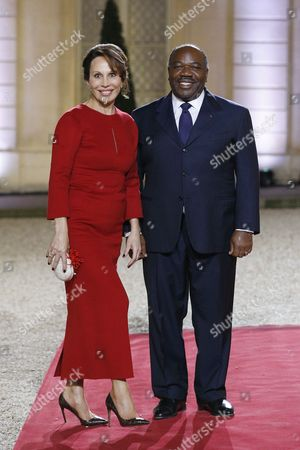 The President of Gabon Ali Bongo Ondimba (r) and His Wife Sylvia (l) Pose For Photographs Prior Attending an Official Diner As Part of the Elysee Summit For Peace and Security in Africa at the Elysee Palace in Paris France 06 December 2013 Elysee Summit For Peace and Security in Africa Takes Place on 06 and 07 December 2013 As France Prepares to Launch Its Second Intervention in Africa in Central African Republic in Under a Year African Leaders Are Bound For Paris to Discuss How to Reduce Their Reliance on the Military Muscle of Former Colonial Powers France Paris