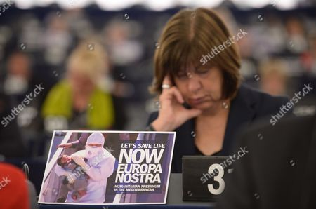 German Rebecca Harms Member of the European Parliament For Alliance 90/the Greens Sits Behind a Placard with the Words 'Let's Save Life Now Europa Nostra' During the Plenary Session in the European Parliament in Strasbourg France 29 April 2015 the House Discuss About the Latest Tragedies in the Mediterranean and Eu Migration and Asylum Policies France Strasbourg