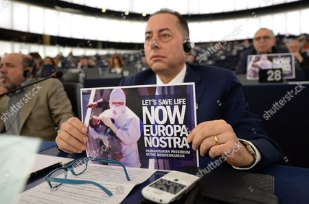 Gianni Pitella From the Group of the Progressive Alliance of Socialists and Democrats in the European Parliament Holds a Placard with the Words 'Let's Save Life Now Europa Nostra' During the Plenary Session in the European Parliament in Strasbourg France 29 April 2015 the House Discuss About the Latest Tragedies in the Mediterranean and Eu Migration and Asylum Policies France Strasbourg