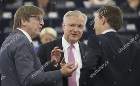 New Mep Former European Commissionner Responsible For Economic and Monetary Affairs and the Euro Olli Rehn Chats with Guy Verhofstadt (l) the Leader of the Alde Liberal Group at the European Parliament and European Parliament Deputy and Chairman of the Alternative For Germany (afd) Party Bernd Lucke (r) During a Plenary Session at European Parliament in Strasbourg France 01 July 2014 the European Parliament is Meeting For the First Plenary Session Since the European Elections in May France Strasbourg