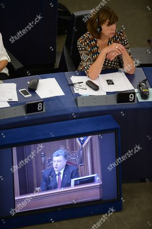 Parliamentary Party Leader of the Greens in the European Parliament Rebecca Harms Listens to a Televized Video Address by Ukrainian President Petro Porochenko at the European Parliament's Plenary Hall in Strasbourg France 16 September 2014 the Parliaments of Ukraine and the European Union Were Set 16 September to Ratify a Landmark Political and Free Trade Deal But Some Lawmakers Expressed Displeasure Over a Delay in the Agreement the Political and Trade Deal Ratified by Parliaments in Ukraine and the European Union Were the First Step Towards Membership in the Bloc Ukrainian President Petro Poroshenko Said Epa/patrick Seeger France Strasbourg