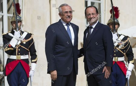Stock Image of French President Francois Hollande (r) Greets Former Lebanese President Michel Sleiman (l) at the Elysee Palace in Paris France 19 June 2014 Sleiman is on a Week-long Official Visit in Paris France Paris