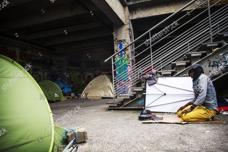 Lybian Migrant Nalaal Prays During the Asr Mid Afternoon Prayer As Part of His Ramadan Observances in the Migrant Camp Located Under the Cit? De La Mode (city of Fashion) Next to the Austerlitz Train Station in the 13th Arrondissement of Paris France 20 June 2015 20 Year Old Nalaal Has Been in France For One Year He Had to Flee Libya to Avoid Imprisonment As His Father was Fighting in the Army of Muammar Al-gaddafi and was Himself a Trainee He is Waiting For His Refugee Status to Be Accepted However Cannot Understand His Living Situation: 'France Waged War on Kadhafi (sic) i Came in France to Find the Land of Equality But This is a Pain' France Paris