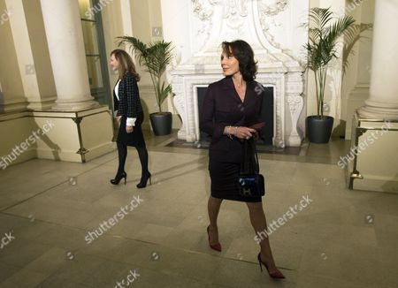 Stock Image of French First Lady Valerie Trierweiler (l) Greets Gabon's First Lady Sylvia Bongo Ondimba (r) As She Arrives For a Meeting Dubbed 'The Mobilisation Against Sexual Violence Towards Women in Conflict' Attended by the First Ladies of African Nations Held Alongside the Summit For Peace and Security in Africa at the Musee D'orsay in Paris France 06 December 2013 France Paris