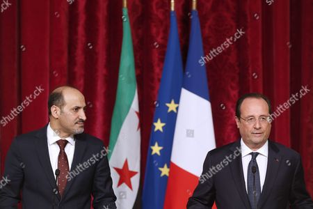 Stock Image of French President Francois Hollande (r) and President of the National Coalition of Syrian Revolutionary and Opposition Forces Ahmad Al-jarba (l) Speak to the Press After Their Meeting at the Elysee Palace in Paris France 20 May 2014 France Paris