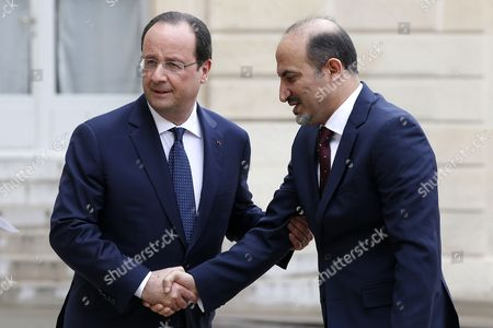 Stock Picture of French President Francois Hollande (l) Greets President of the National Coalition of Syrian Revolutionary and Opposition Forces Ahmad Al-jarba (r) Upon His Arrival at the Elysee Palace in Paris France 20 May 2014 Ahmad Al-jarba is on an Official Visit to Paris France Paris