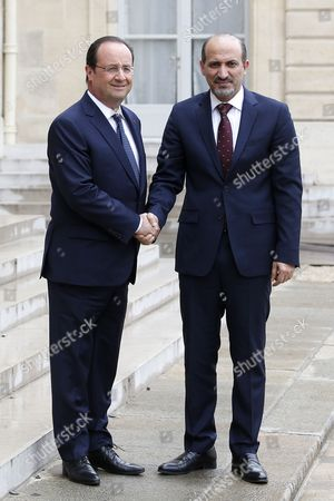 French President Francois Hollande (l) Greets President of the National Coalition of Syrian Revolutionary and Opposition Forces Ahmad Al-jarba (r) Upon His Arrival at the Elysee Palace in Paris France 20 May 2014 Ahmad Al-jarba is on an Official Visit to Paris France Paris