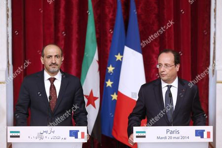 French President Francois Hollande (r) and President of the National Coalition of Syrian Revolutionary and Opposition Forces Ahmad Al-jarba (l) Speak to the Press After Their Meeting at the Elysee Palace in Paris France 20 May 2014 France Paris