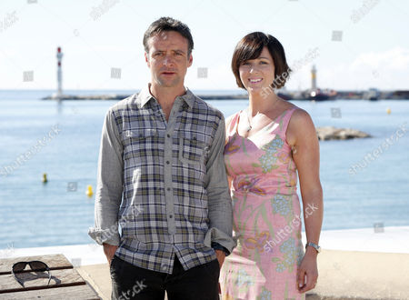Welsh Actors Mali Harries (r) and Richard Harrington (l) Pose During a Photocall For the Tv Series ' Hinterland' at the Annual Mipcom Television Content Market in Cannes France 08 October 2013 the Media Event Runs From 07 to 10 October France Cannes