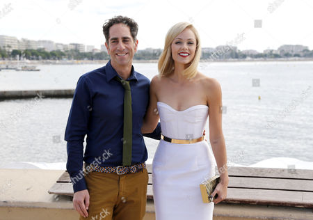 Stock Picture of Canadian Actress Laura Diane Vandervoort and Canadian Producer J B Sugar (l) Pose During a Photocall For the Tv Serie 'Bitten' at the Annual Mipcom Television Content Market in Cannes France 07 October 2013 the Media Event Runs From 07 to 10 October France Cannes