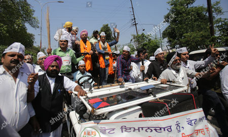 Indian Actress and Aam Aadmi Party's (aap) Candidate From Chandigarh Gul Panag (r-front on Vehicle) Waves As She Campaigns For Aap Candidate For the Upcoming Parliamentary Elections From Amritsar Daljit Singh (l-on Vehicle Wearing Orange Robe) During a Roadshow in Amritsar India 19 April 2014 Parliamentary Elections Are Scheduled to Be Held on 30 April in the State of Punjab India Amritsar