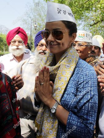 Indian Actress and Aam Aadmi Party's (aap) Candidate From Chandigarh Gul Panag Greets Supporters As She Arrives to Campaign For Aap Candidate For the Upcoming Parliamentary Elections From Amritsar Daljit Singh (unseen) in Amritsar India 19 April 2014 Parliamentary Elections Are Scheduled to Be Held on 30 April in the State of Punjab India Amritsar