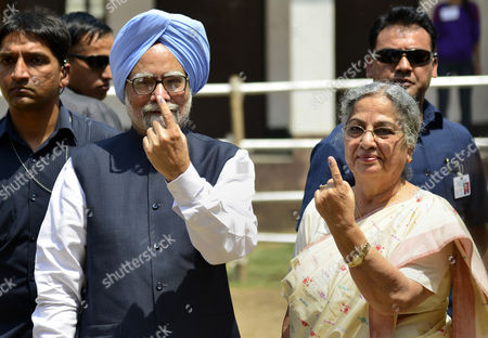 Stock Photo of Indian Prime Minister Manmohan Singh Along with His Wife Gursharan Kaur Shows the Ink Mark of Their Fingers After Casting Their Votes During the Third and Last Phase of the Indian General Election in Guwahati City India 24 April 2014 Millions of Indians Voting For the Sixth and Secondá Biggest Phase of Nine Phases of Polling For 117 Seats Spread Across 12 Indian States As India's Five-week Parliamentary Elections Entered Their Sixth Phase on 24 April with the India's Financial Capital Mumbai Voting Elections Will Take Place in Ten Phases and is Due to End on 12 May India Guwahati