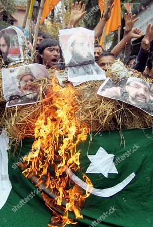 Indian Activists of Hindu Right Wing Shiv Sena Burn an Effigy of Kashmiri Separatist Leaders Masarat Alam Bhat and Syed Ali Shah Geelani with Pakistani Flag During Protest Demonstration in Jammu the Winter Capital of Kashmir India 16 April 2015 According to the News Reports Political Parties Demanded Stern Action Against Masarat Alam and Others For Chanting Pro-pakistan Slogans and Raising of Pakistani Flags at the Rally Held by Separatist Leaders in Srinagar India India Jammu