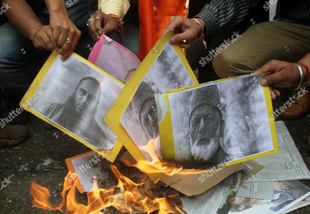 Stock Image of Indian Activists of Hindu Right-wing Shiv Sena Burn the Posters of Kashmiri Separatist Leaders Masarat Alam Bhat and Syed Ali Shah Geelani During Protest Demonstration in Jammu the Winter Capital of Kashmir India 16 April 2015 According to the News Reports Political Parties Demanded Stern Action Against Masarat Alam and Others For Chanting Pro-pakistan Slogans and Raising of Pakistani Flags at the Rally Held by Separatist Leaders in Srinagar India India Jammu