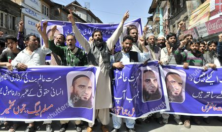Activists and Supporters of Muslim League Jammu Kashmir (mljk) Shout Slogans During a Protest Against Slapping of Public Safety Act (psa) on Senior Separatist Leader Masarat Alam Bhat in Srinagar the Summer Capital of Indian Kashmir 24 April 2015 Bhat was Arrested After Raising Pro-pakistan Slogans at a Separatist Rally in Which Activists Waved Pakistani Flags the Hardline Faction of Aphc Has Called For a Kashmir-wide Shutdown on 25 April 2015 India Srinagar