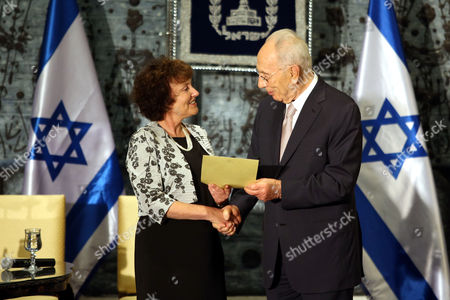 Stock Photo of Karnit Flug (l) the New Governor of the Bank of Israel Receives Her Certificate by Israeli President Shimon Peres (r) During Her Appointment Ceremony at the Israeli President's Residence in Jerusalem 13 November 2013 Karnit Flug is the First Woman to Hold the Position of the Bank of Israel Governor in Israel's History Flug is Replacing Us-israeli Economist Stanley Fischer who Held the Post For the Past Eight Years Flug who Studied at Columbia University New York was Born in Poland in 1955 She Moved to Israel with Her Family As a Toddler Israel Jerusalem