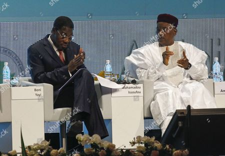 Yayi Boni President of Benin (l) and Mahamadou Issoufou President of Niger (r) During the Opening Ceremony of the African Development Bank 50th Anniversary Forum in Abidjan Ivory Coast 26 May 2015 the Launch of the Joint Annual Report on Africa's Economic Performance Produced by the African Development Bank the Oecd Development Centre and the Un Development Programme is Taking Place in Abidjan Ivory Coast Between 25-29 May 2015 Cote D'ivoire Abidjan
