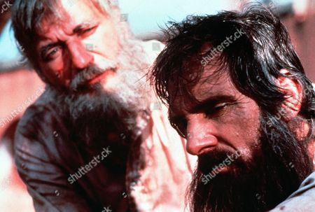 'The Ordeal of Dr. Mudd'  TV Film - 1980 -      Dr Samuel Mudd (Dennis Weaver) with long beard and looking tired is talked to by Colonel George Grenfell (Nigel Davenport).