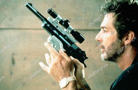 P.C.H.  TV Film - 1995 -    Daniel St Germain (Jack Scalia) preparing his gun, gets ready to assasinate his ex-wife.