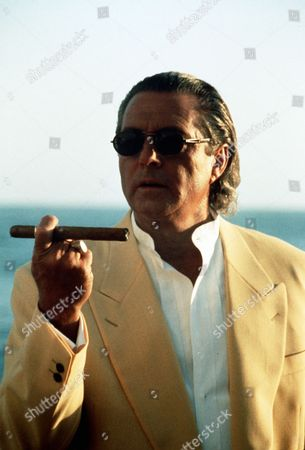 P.C.H.  TV Film - 1995 -    Jake (Gianni Russo) smokes a cigar.