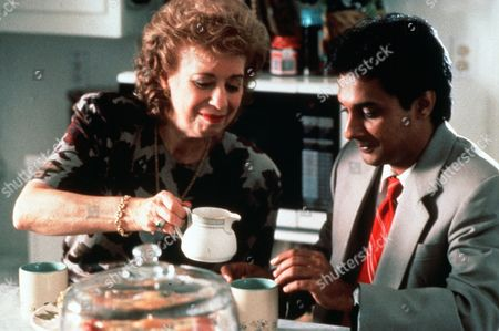 Stock Photo of 'Sam & Me'  Film - 1991 -   Nikhil Parikh (Ranjit Chowdhry) is served a cup of tea by Hannah Cohen (Marcia Diamond).
