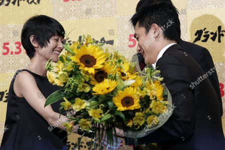 Hong Kong Actor/cast Member Tony Leung (r) Receives a Flower Bouquet From Japanese Actress Yoko Maki on Stage During the Premiere of 'The Grandmaster' in Tokyo Japan 30 May 2013 the Martial Arts Drama Movie Directed by Wong Kar-wai Will Be Released in Japanese Theatres on 31 May Japan Tokyo