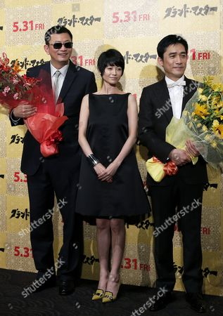 (l-r) Hong Kong Director Wong Kar-wai Japanese Actress Yoko Maki and Hong Kong Actor/cast Member Tony Leung Wave As They Pose on Stage During the Premiere of 'The Grandmaster' in Tokyo Japan 30 May 2013 the Martial Arts Drama Movie Directed by Wong Kar-wai Will Be Released in Japanese Theatres on 31 May Japan Tokyo